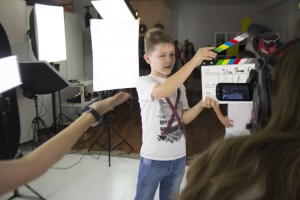 Kid and clapper board
