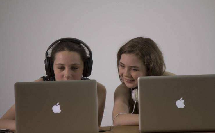 CTA Girls behind laptops